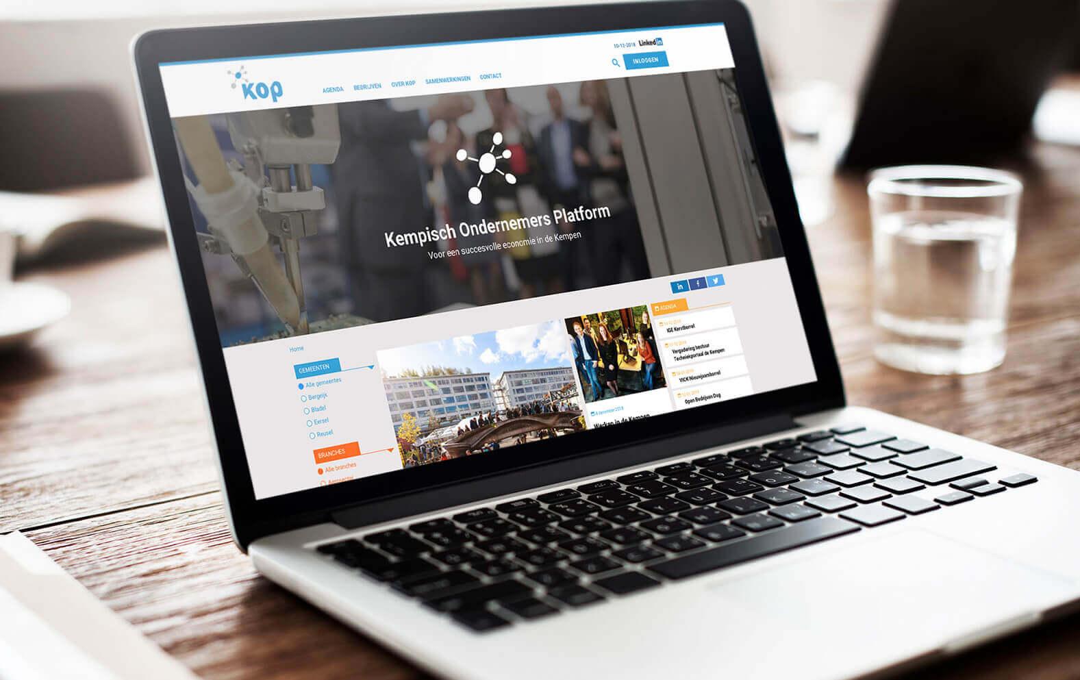 Het Kop website homepage op laptop